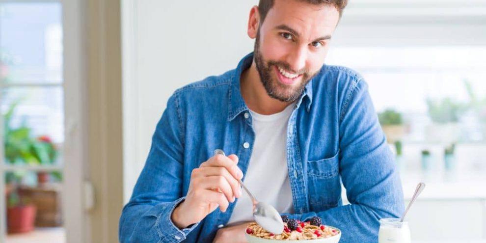 Man eating breakfast.